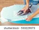 closeup of woman ironing... | Shutterstock . vector #533229073