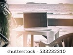 computer on table outside on... | Shutterstock . vector #533232310