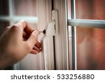 man s hand locking or opening a ... | Shutterstock . vector #533256880