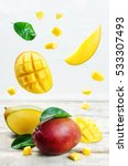 mango with flying slices on a... | Shutterstock . vector #533307493