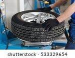 Mechanic Removes Car Tire...