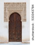 Small photo of Interior of Alhambra, Granada, Andalusia, Spain. Ancient door with arabesques decoration.