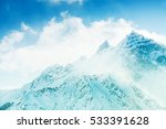 Snow Covered Mountains At...