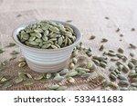 roasted pumpkin kernels in a... | Shutterstock . vector #533411683