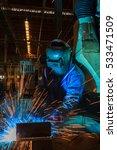 worker is welding metal in... | Shutterstock . vector #533471509