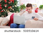 Young Man Shopping Online With...