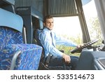 handsome driver sitting in bus | Shutterstock . vector #533514673