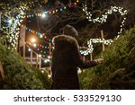 Lady Picking Christmas Tree