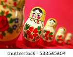 Russian Dolls On Red Background