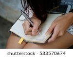 woman right hand writing