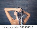 young woman washing hair in...   Shutterstock . vector #533580310