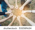 Small photo of A group people fist hand altogether