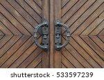 wooden door with iron handles | Shutterstock . vector #533597239
