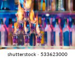 pyramid of shot glasses with... | Shutterstock . vector #533623000