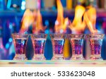 five shot glasses with flaming... | Shutterstock . vector #533623048