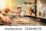 hand of man take cooking of... | Shutterstock . vector #533648170