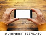 man using smart phone in... | Shutterstock . vector #533701450