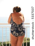 Obese woman in bathing suit - stock photo