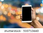 hand holding a smartphon on... | Shutterstock . vector #533713660