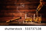 pouring whiskey from bottle to... | Shutterstock . vector #533737138