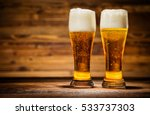 two glasses of lager served on... | Shutterstock . vector #533737303