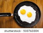 fried eggs meal in a frying pan ... | Shutterstock . vector #533763304