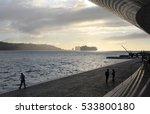 Seashore In Lisbon With A Ship...