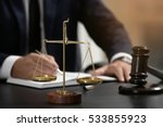 Stock photo scales of justice and judge gavel on table closeup 533855923