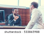smiling businessmen at meeting... | Shutterstock . vector #533865988