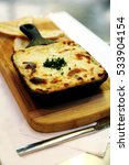 a meal made with melted cheese... | Shutterstock . vector #533904154