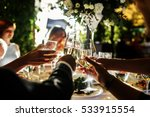 people clang glasses sitting at ... | Shutterstock . vector #533915554