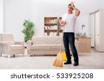 man cleaning home with broom | Shutterstock . vector #533925208