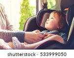 toddler girl buckled into her... | Shutterstock . vector #533999050