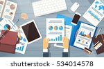 business man hand hold... | Shutterstock .eps vector #534014578