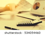 calculator on the desk with a... | Shutterstock . vector #534054460