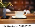 cup of coffee and a phone on... | Shutterstock . vector #534095989