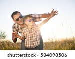 father and son playing on the... | Shutterstock . vector #534098506
