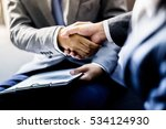 businessman shaking hands to... | Shutterstock . vector #534124930