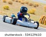 young kid racing a go cart... | Shutterstock . vector #534129610