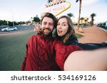 happy young couple of tourists... | Shutterstock . vector #534169126