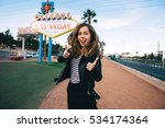 happy young woman taking photo... | Shutterstock . vector #534174364