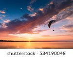 silhouette of flying paraglide... | Shutterstock . vector #534190048