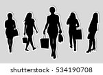 girl with bags black dynamic... | Shutterstock .eps vector #534190708