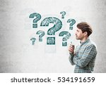 side view of a man holding a... | Shutterstock . vector #534191659