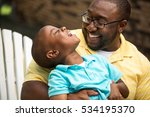 father and son laughing. | Shutterstock . vector #534195370
