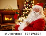 santa claus eats cookies and... | Shutterstock . vector #534196834