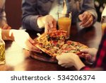friends taking slices of tasty... | Shutterstock . vector #534206374