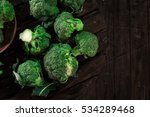 fresh green broccoli in wood... | Shutterstock . vector #534289468