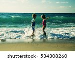 kids playing on the beach at... | Shutterstock . vector #534308260
