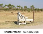 Small photo of Vintage agricultural equipment in Kalahari desert, Namibia. Agribusiness in Africa